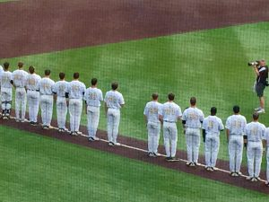 Vanderbilt teammates leave a space in their line for their fallen teammate, Donny Everett.