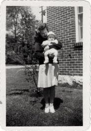Aunt Colleen and a goofy kid outside 127 Castle Heights Avenue, Lebanon, TN, circa 1945